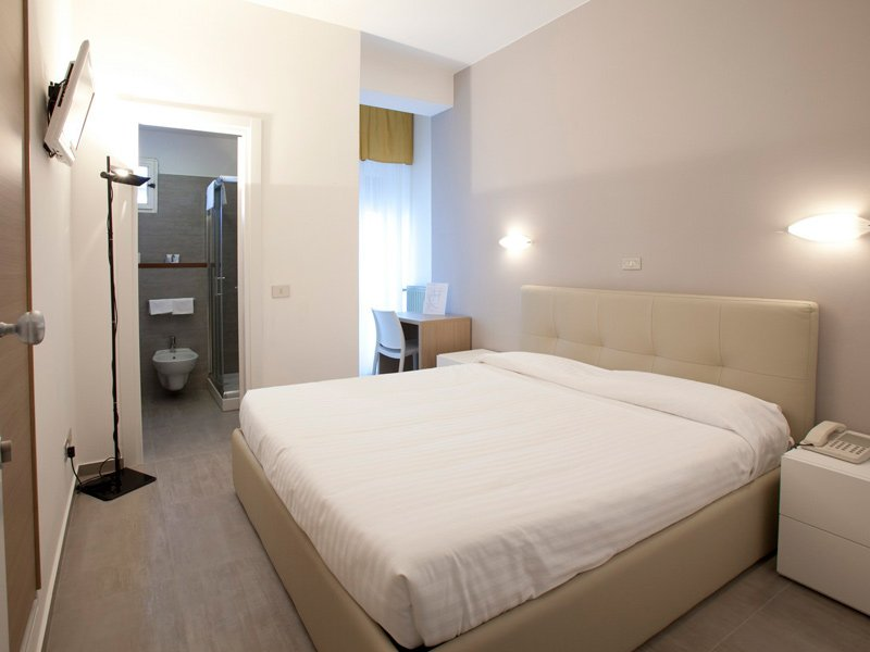 De comfortabele tweepersoonskamer in Hotel Il Continental