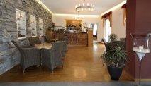 De gezellige bar in Hotel Cortese