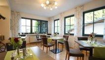De gezellige ontbijtruimte van Hotel Villa Moritz