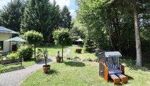 In de prachtige tuin van Hotel Villa Moritz is het goed ontspannen