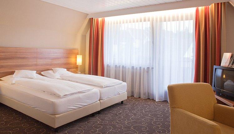 De tweepersoonskamers Comfort zijn van alle gemakken voorzien