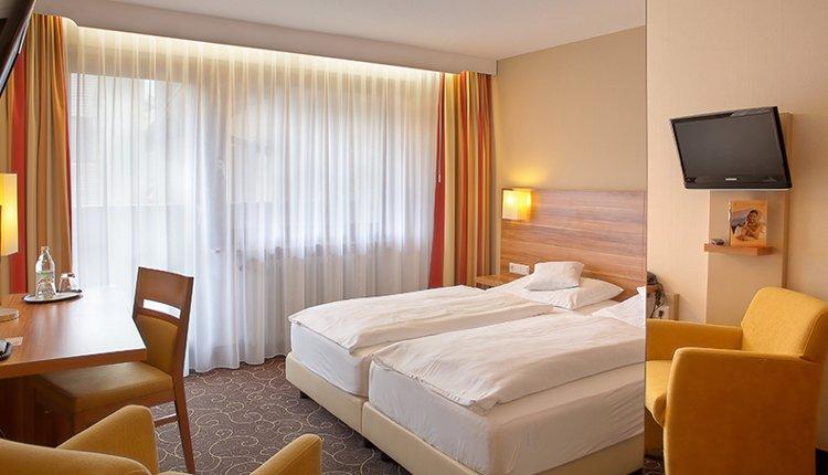 De tweepersoonskamers van Flair Hotel Lochner zijn sfeervol ingericht