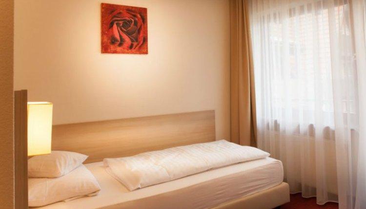 De eenpersoonskamer in Flair Hotel Lochner is comfortabel
