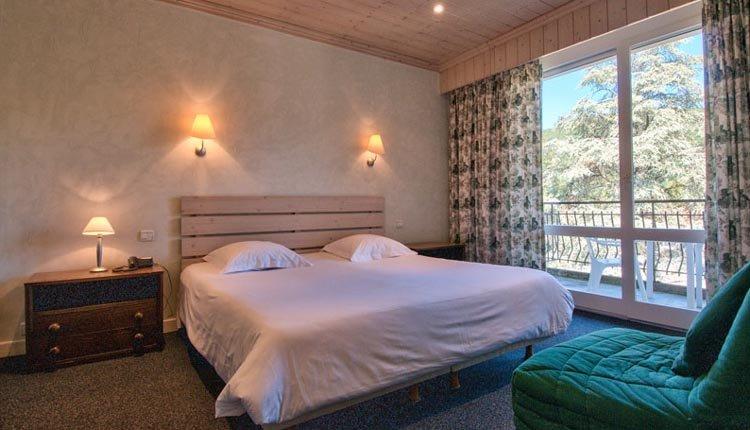 De tweepersoonskamers van Hotel Du Lac met tuinzicht