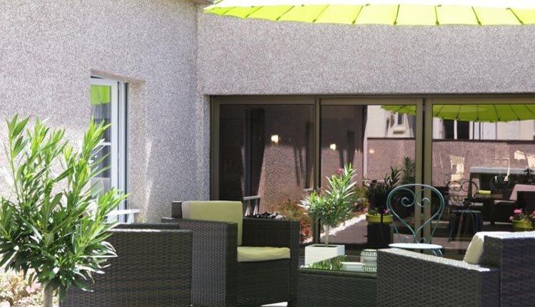 Het gezellige terras van Best Western Plus L'Artist Hotel