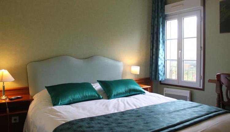 De tweepersoonskamers in Hotel Le Clos de Mutigny zijn comfortabel