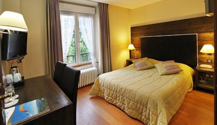 De tweepersoonskamers classic in Hotel de la Jamagne zijn sfeervol ingericht