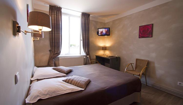 """De tweepersoonskamers """"Fleuri"""" in Hotel La Residence zijn comfortabel"""