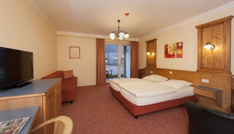 De tweepersoonskamer de luxe met balkon