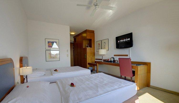 De tweepersoonskamers in Hotel Atrigon zijn van alle gemakken voorzien