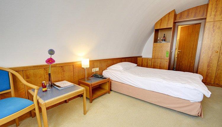 De eenpersoonskamers in Hotel Atrigon zijn van alle gemakken voorzien
