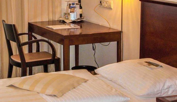 De eenpersoonskamers in Hotel Sandwirth zijn comfortabel
