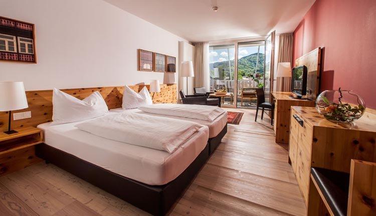 De tweepersoonskamers van Villa Seilern Vital Resort zijn sfeervol ingericht
