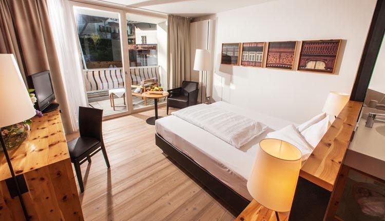 De eenpersoonskamers van Villa Seilern Vital Resort zijn sfeervol ingericht