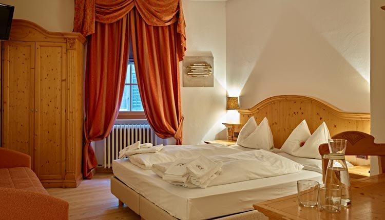 De tweepersoonskamers in Romantic Hotel Excelsior zijn comfortabel en sfeervol ingericht