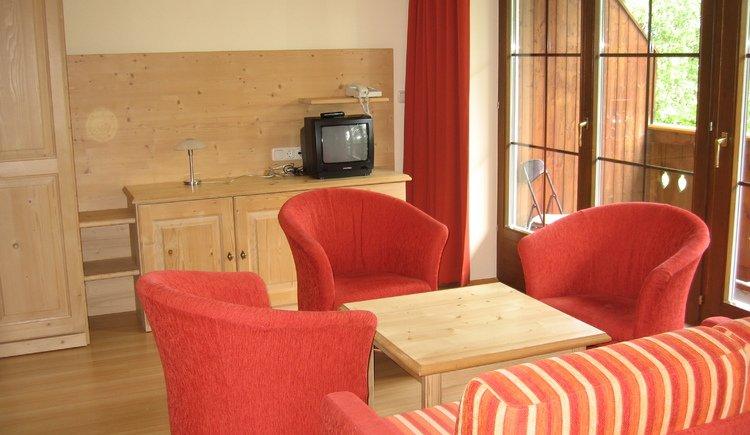 De tweepersoonskamers in Hotel Carossa zijn gezellig ingericht