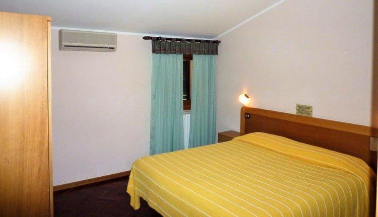 De comfortabele tweepersoonskamers van Hotel La Torretta
